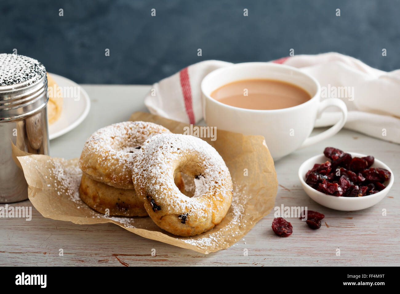 Vanilla baked donuts with dried cranberries - Stock Image
