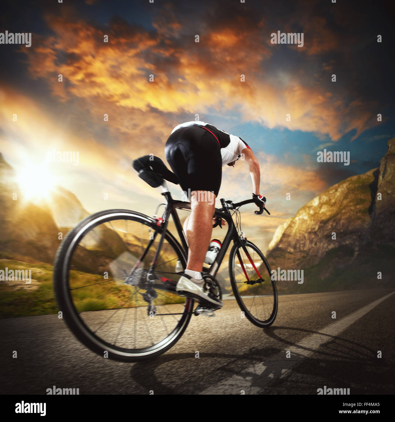 Riding between  the mountains - Stock Image