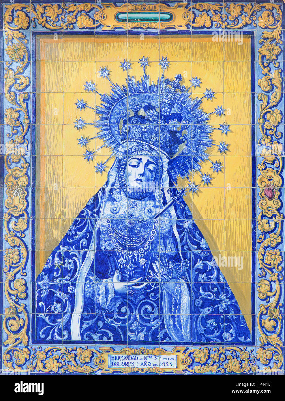 CORDOBA, SPAIN - MAY 27, 2015: The ceramic tiled, cried Madonna by J. Rodroguez Ritton on the Cueste del Bailio - Stock Image