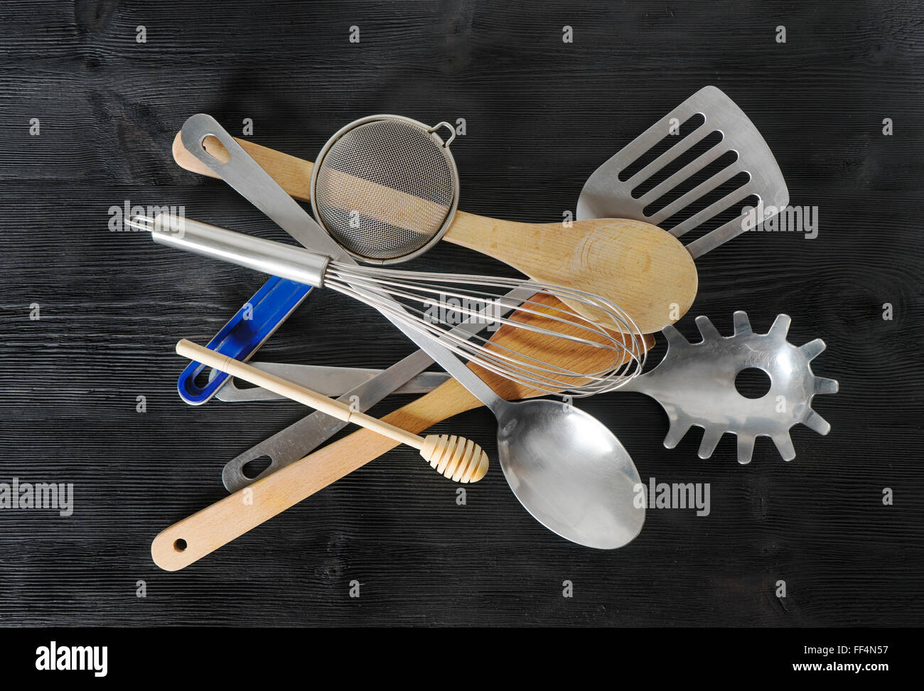 Set  of kitchen utensils on black background - Stock Image