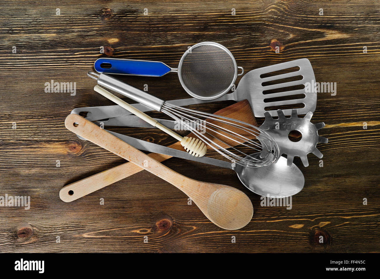 Set  of kitchen utensils on brown background - Stock Image