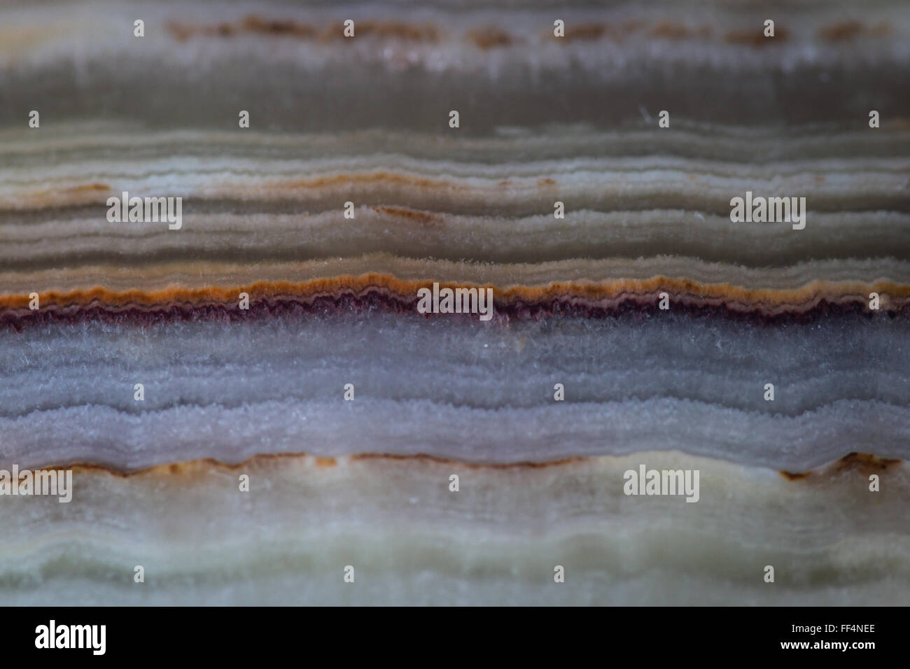 close up of a beautiful polished stone with a beautiful pattern with layers and colors - Stock Image
