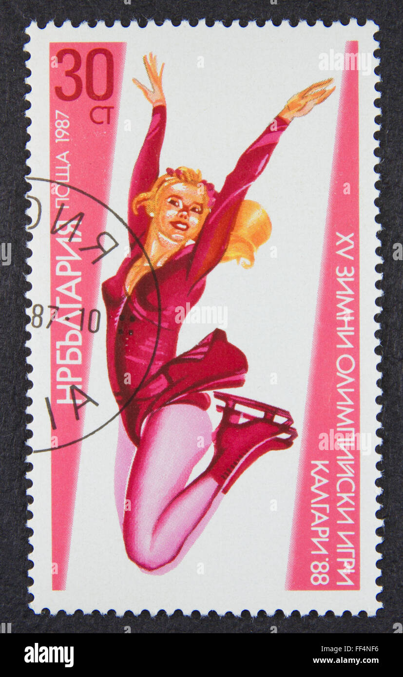 A stamp printed in Bulgaria, shows Women's figure skating in 1988 Winter Olympics, Calgary series, 1987 - Stock Image