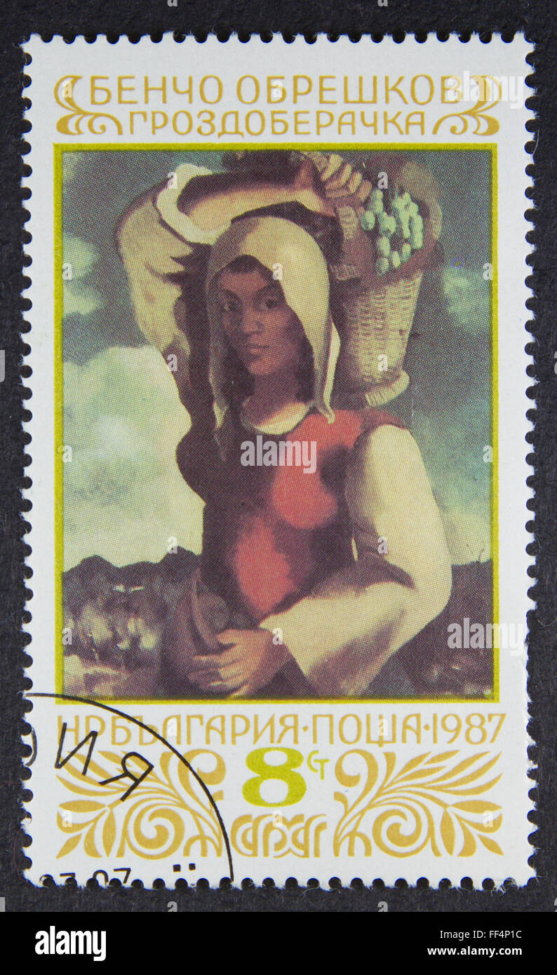 A stamp printed in Bulgaria, shows Grape gatherer, by Bencho Obreshkov, 1987 - Stock Image
