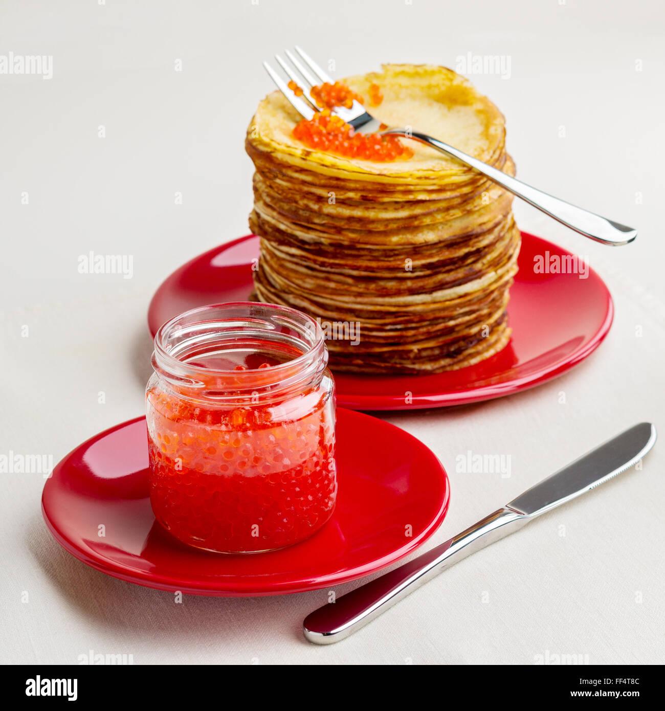 Pancake week. Pancakes with red caviar. Selective focus. - Stock Image