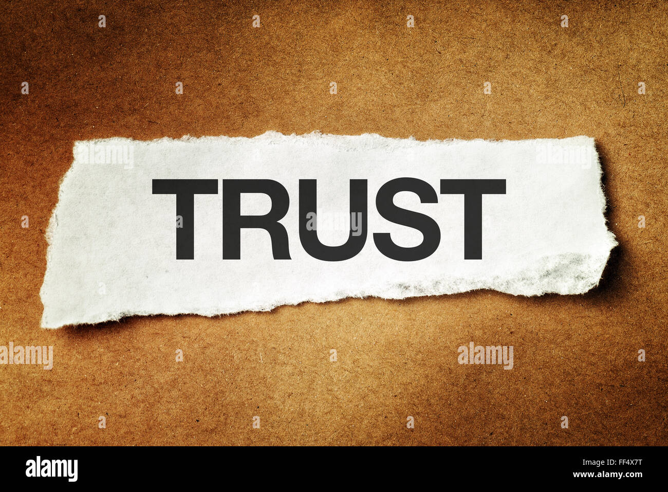 Trust printed on scrap paper, concept of faith, confidence and trustworthy. - Stock Image