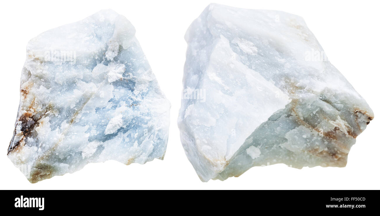 macro shooting of natural mineral stone - two pieces blue Anhydrite (Angelite) rock isolated on white background - Stock Image