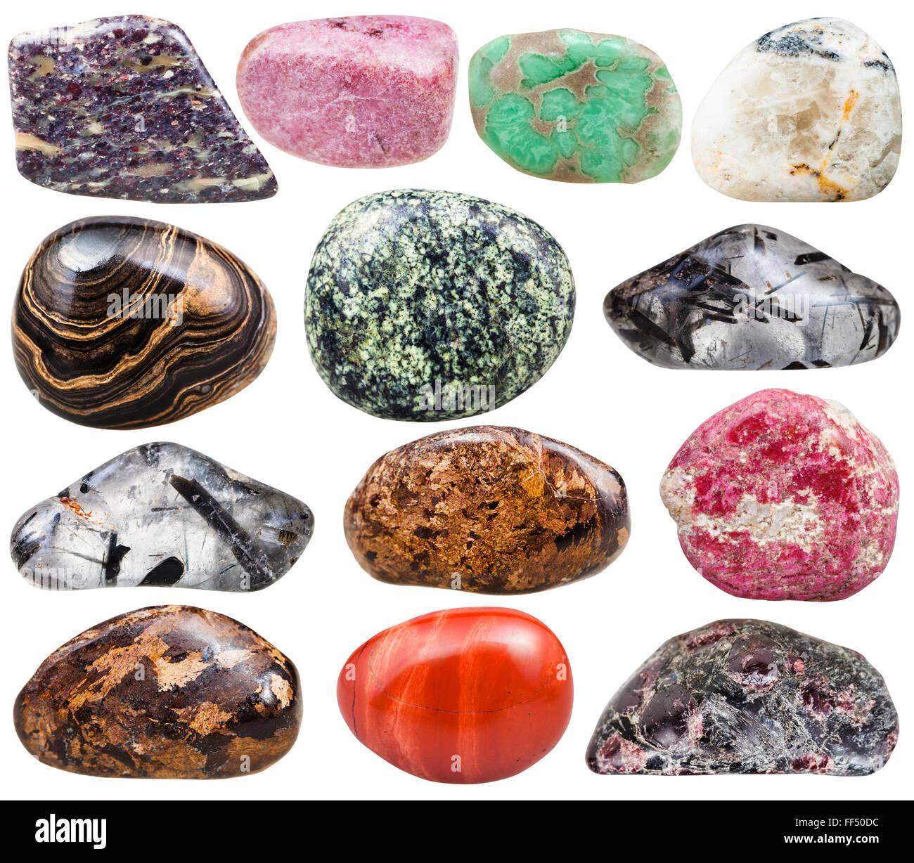 collection of natural mineral tumbled gemstones - bronzite, quartz, variscite, thulite, rosaline, zoisite, red jasper, - Stock Image