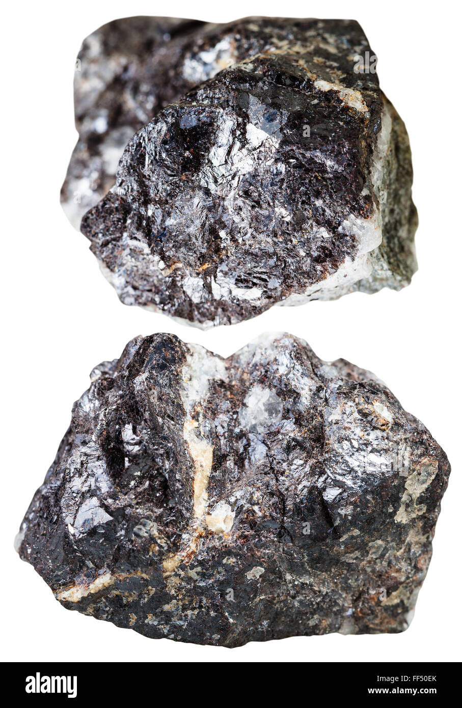 macro shooting of natural mineral stone - two pieces of sphalerite (zinc blende) rock isolated on white background - Stock Image
