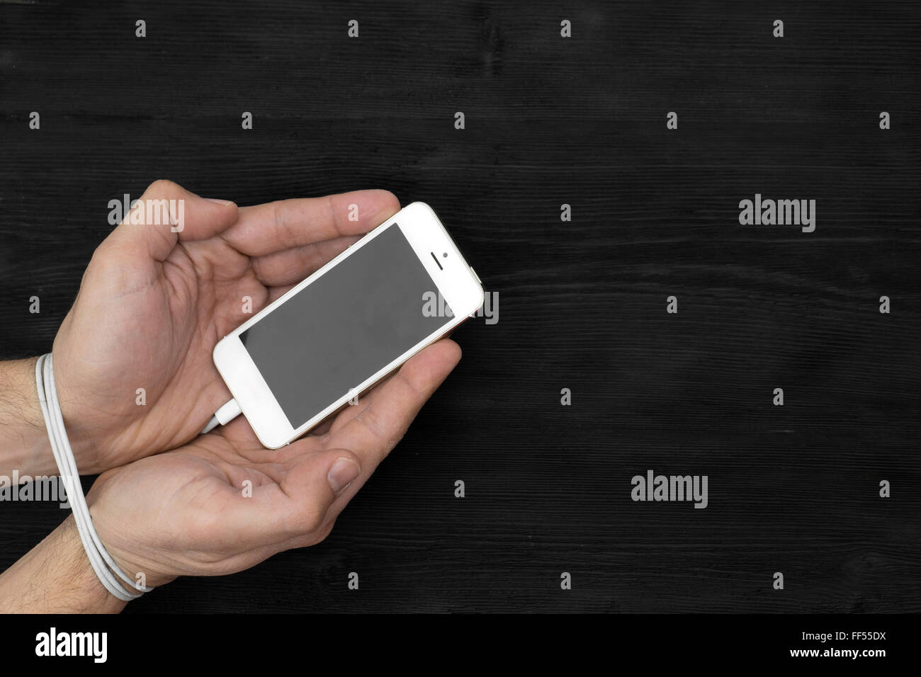 Male hands and smartphone. Addiction to internet and social networks - Stock Image