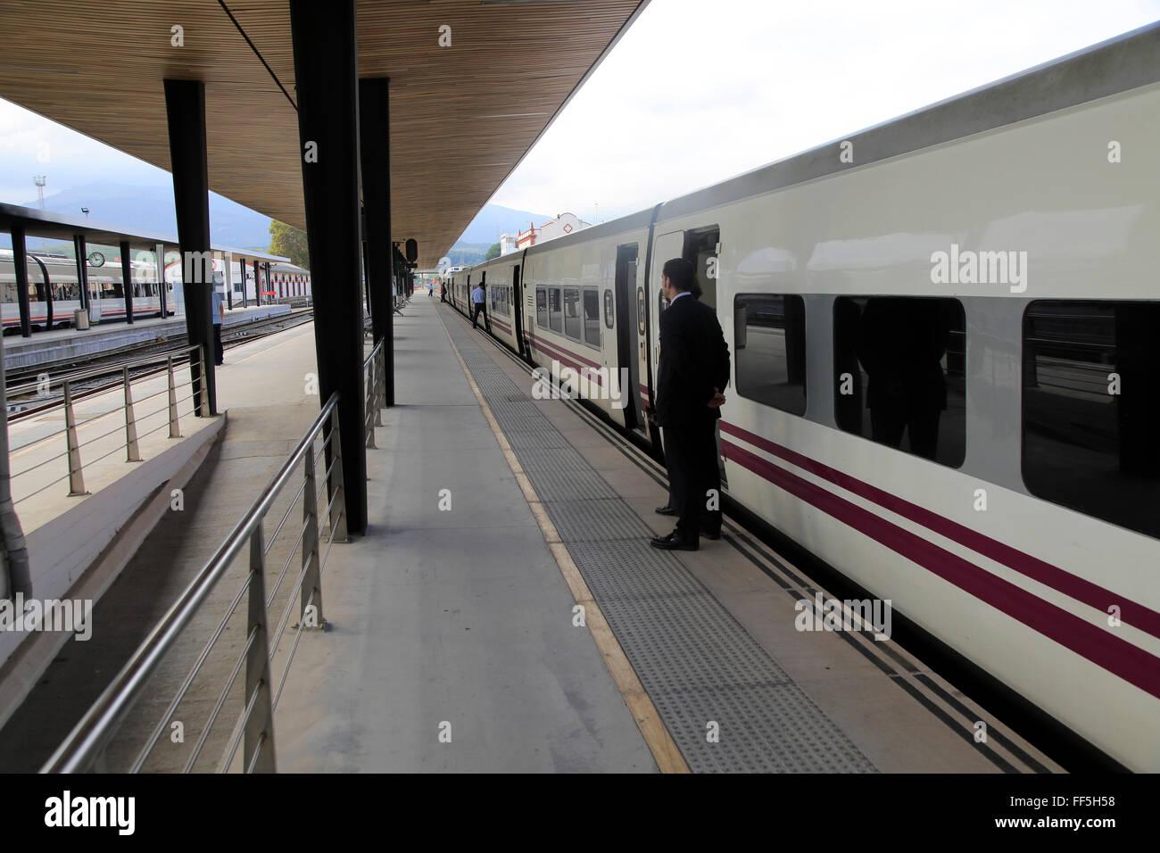 Train awaiting departure on platform at railway station, Algeciras, Cadiz province, Spain - Stock Image