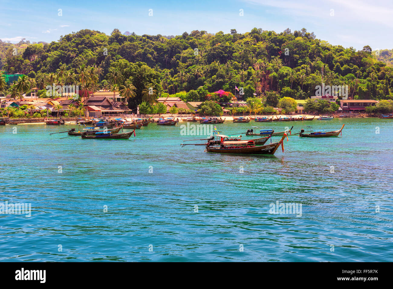 Long tail boats in Harbour Phi Phi Island, Krabi, Thailand - Stock Image