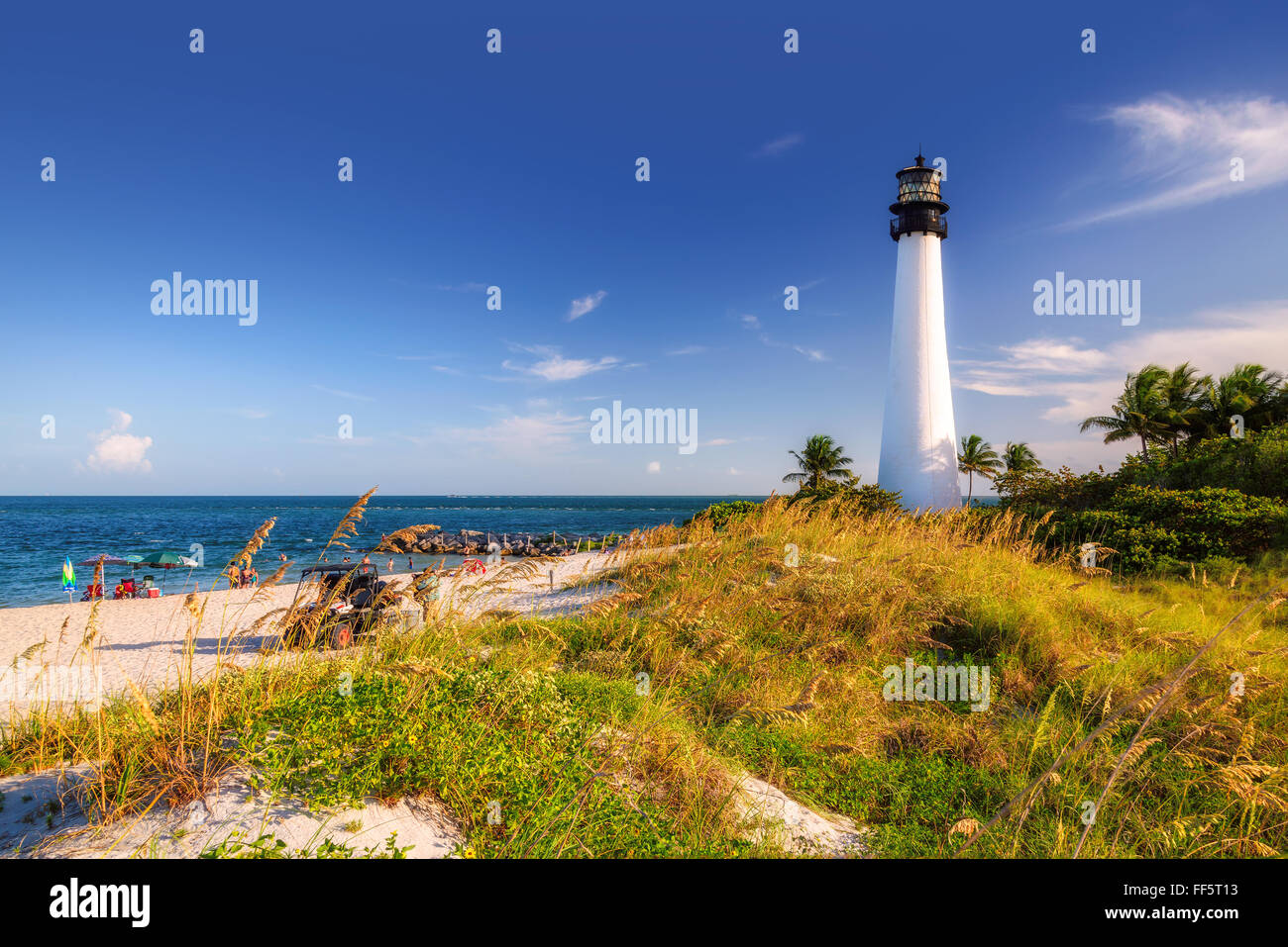 The Beach and Cape Florida lighthouse at sunset, Key Biscayne, Miami Stock Photo
