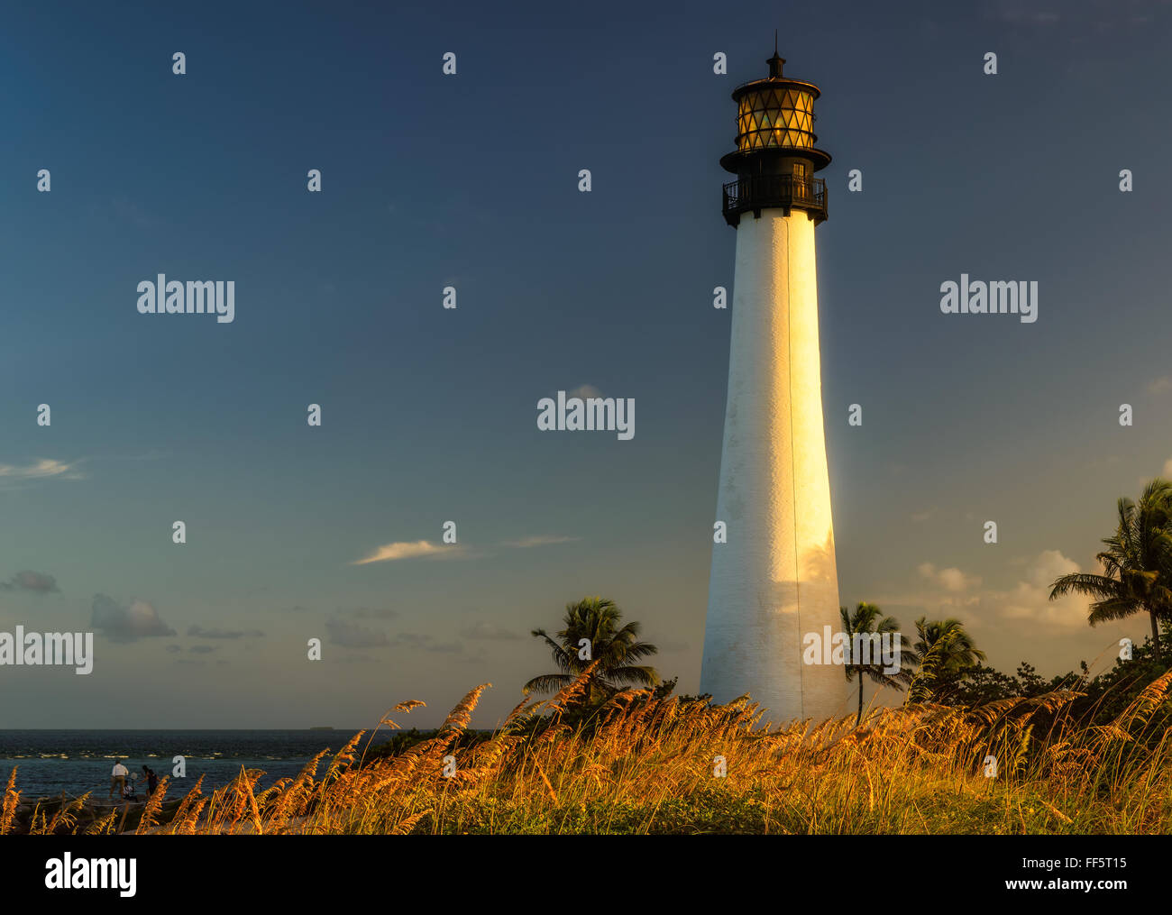 Famous lighthouse at sunset at Cape Florida in the south end of Key Biscayne , Miami Stock Photo