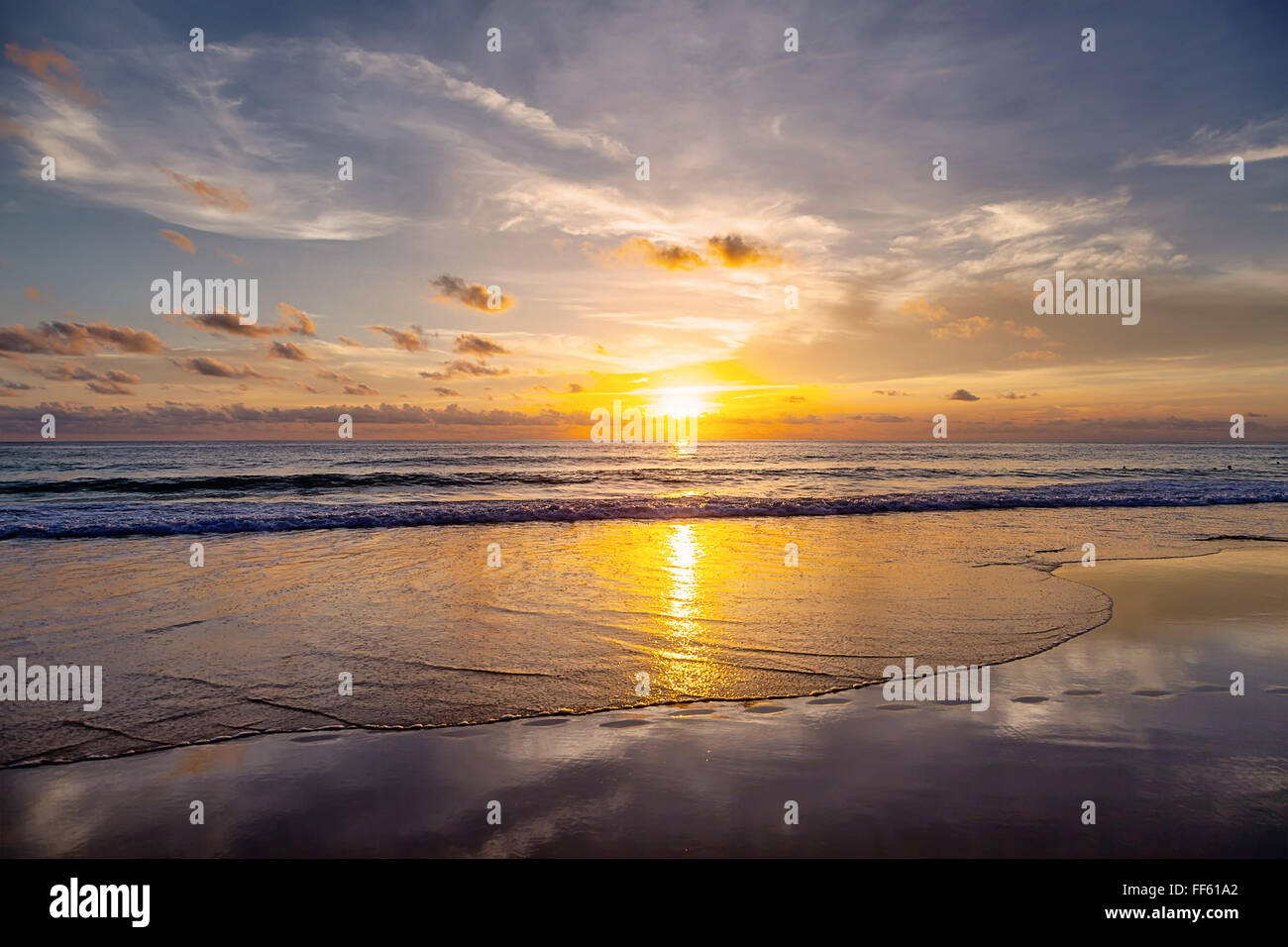 Sunset on the beach of Patong. Phuket Island. Thailand. - Stock Image