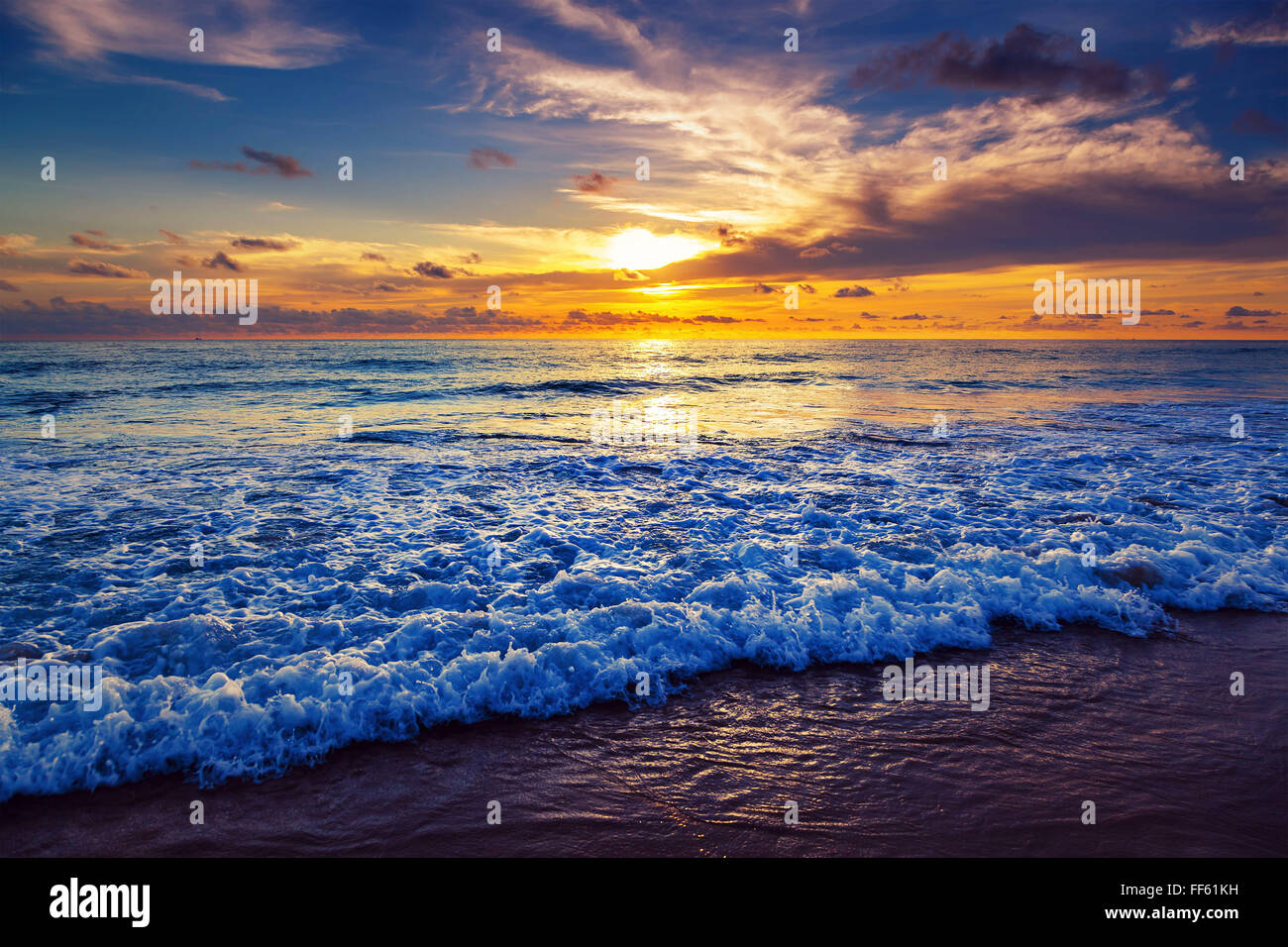 Sunset on Karon Beach. Phuket Island. Thailand. - Stock Image