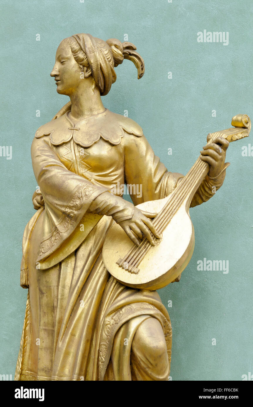 Gilded sandstone statue of a woman playing the lute, Chinese House, Sanssouci Park, Potsdam, Germany - Stock Image