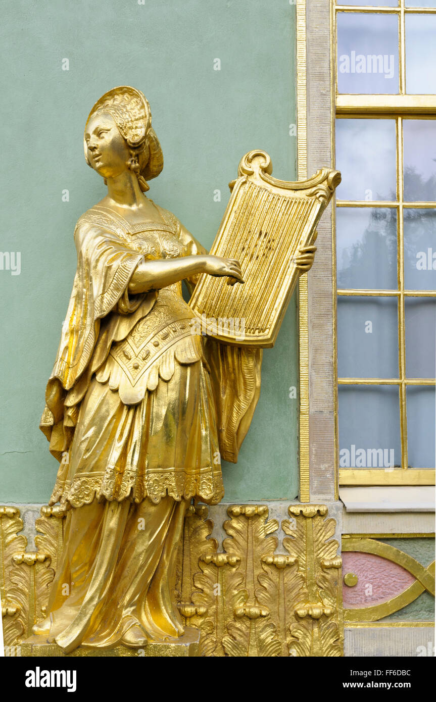 Gilded sandstone statue of a woman playing the lyre, Chinese House, Sanssouci Park, Potsdam, Germany - Stock Image