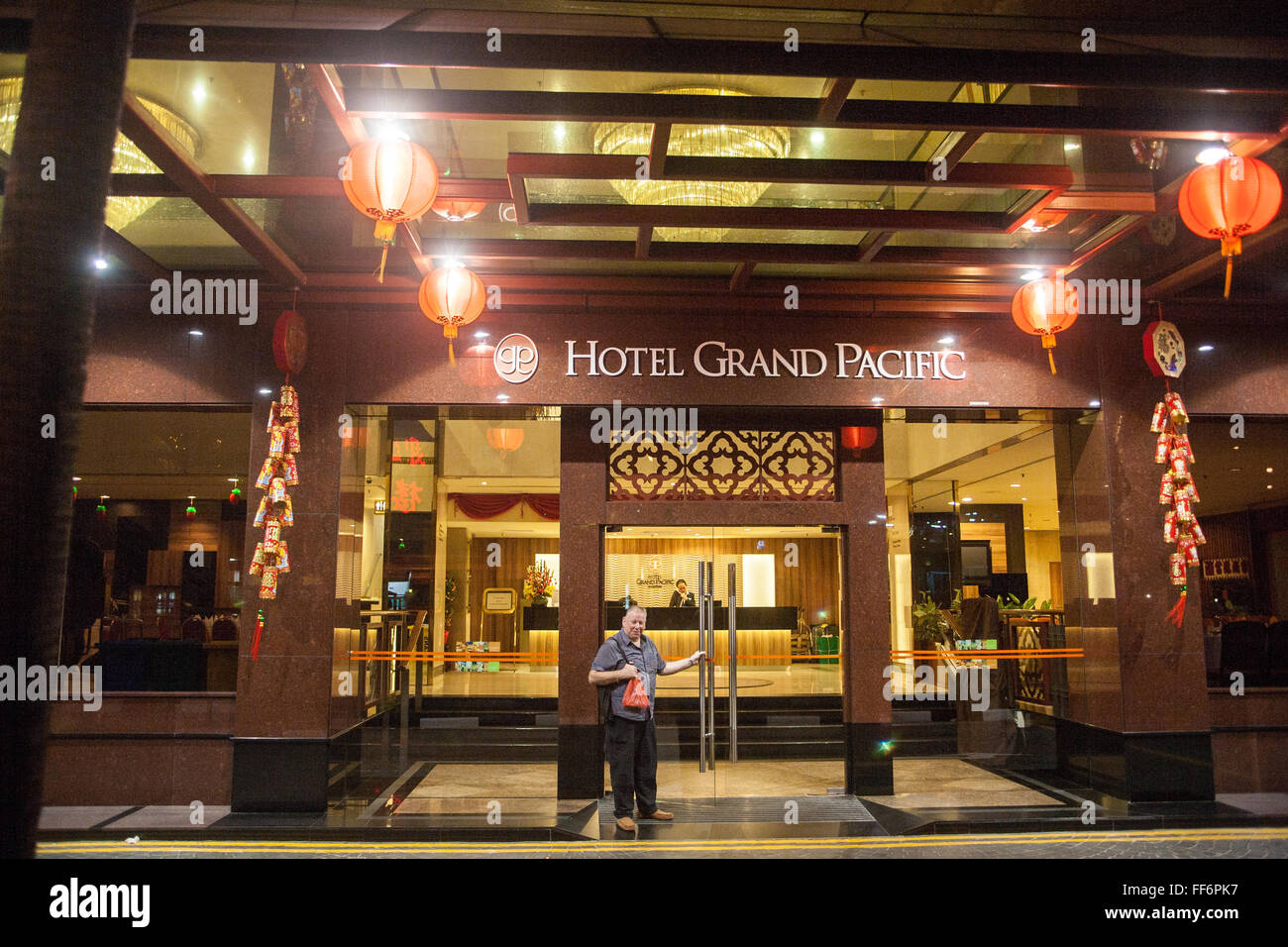 British Tourist At Entrance To Hotel Grand Pacific Hotel In Centre