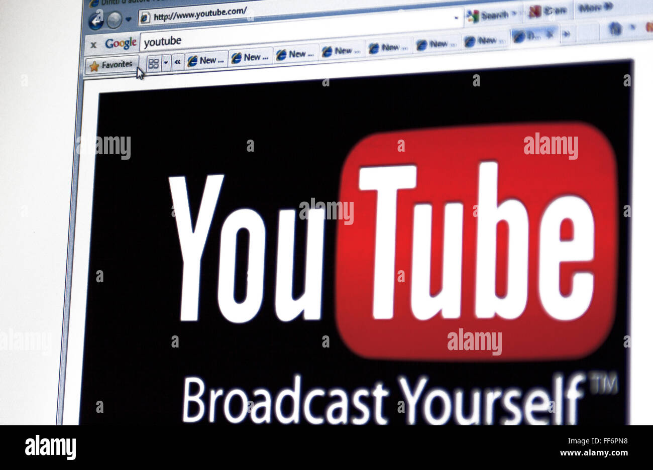 A close up shot of an LCD screen showing the Youtube logo on the