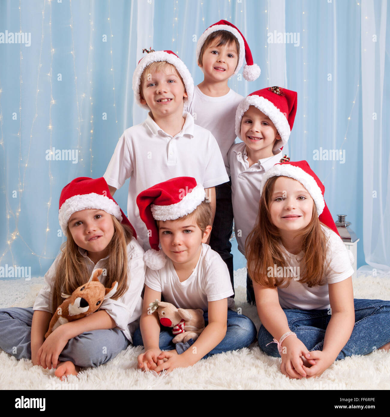 Six sweet kids, preschool children, having fun for christmas, square format - Stock Image