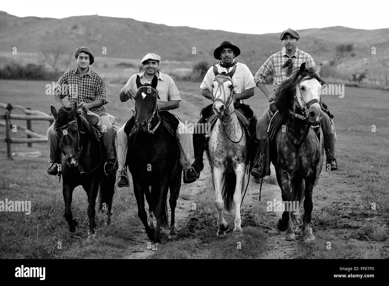 Gauchos ride through the Sierras Chicas in the Cordoba countryside, Argentina - Stock Image