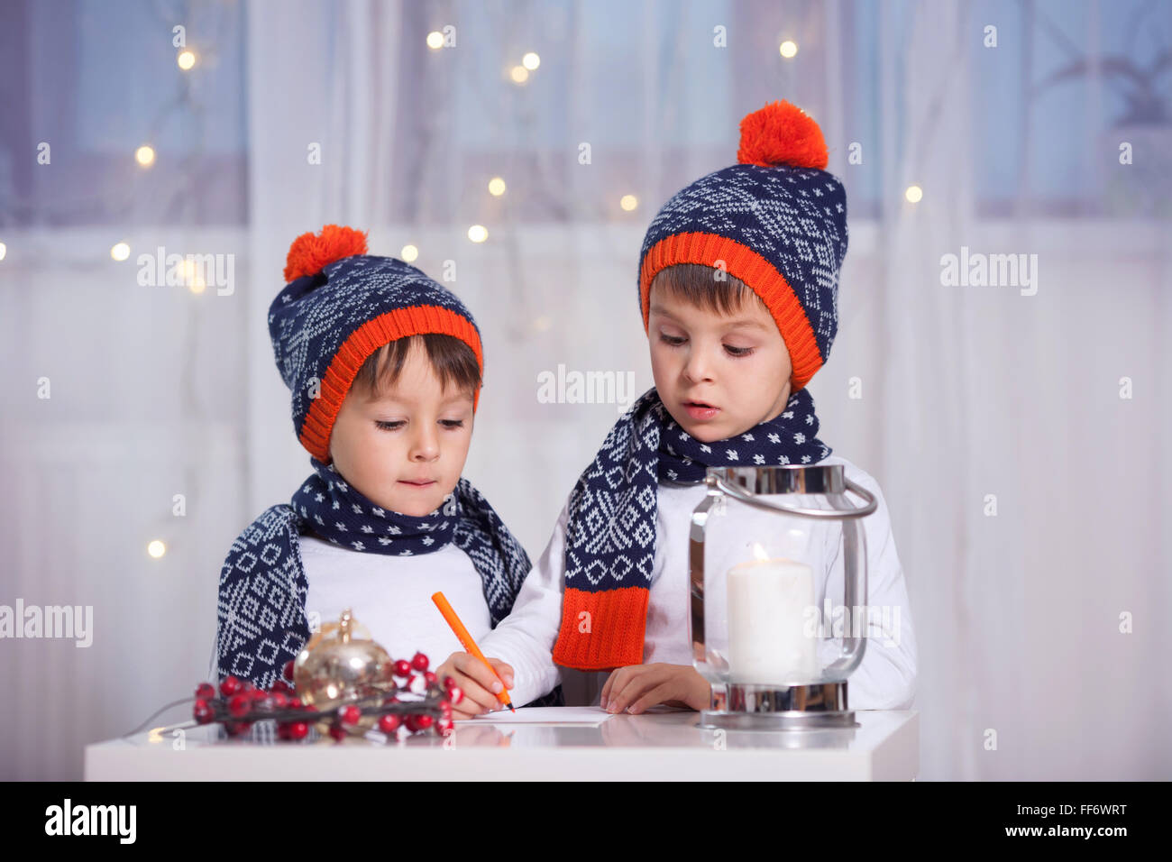 Two adorable little preschooler children, boy brothers, writing letter to Santa - Stock Image