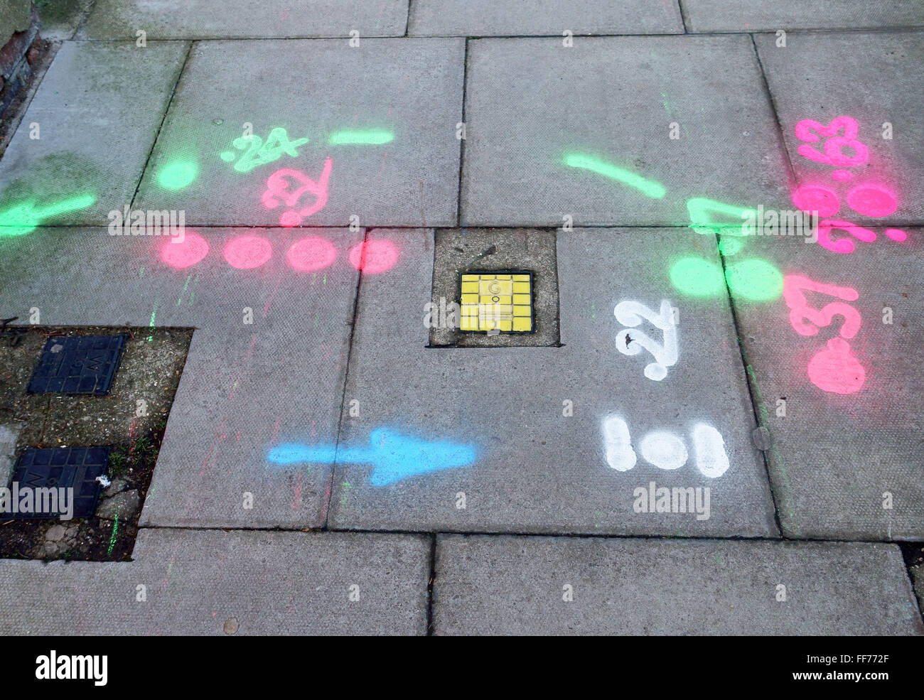 Painted marks on pavement prior to utilities excavations, London - Stock Image