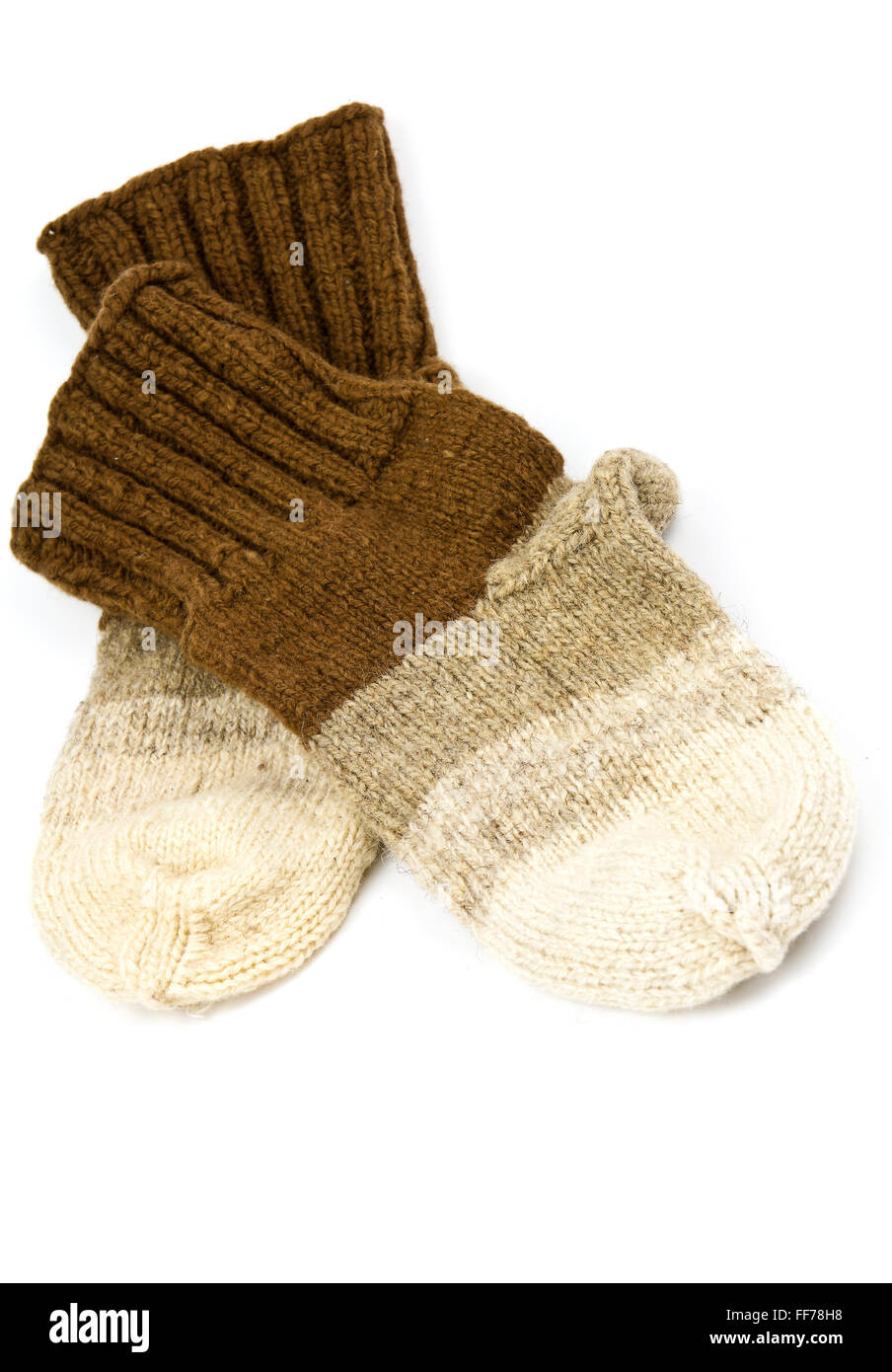 Traditional hand-knit wool socks in three colors - Stock Image