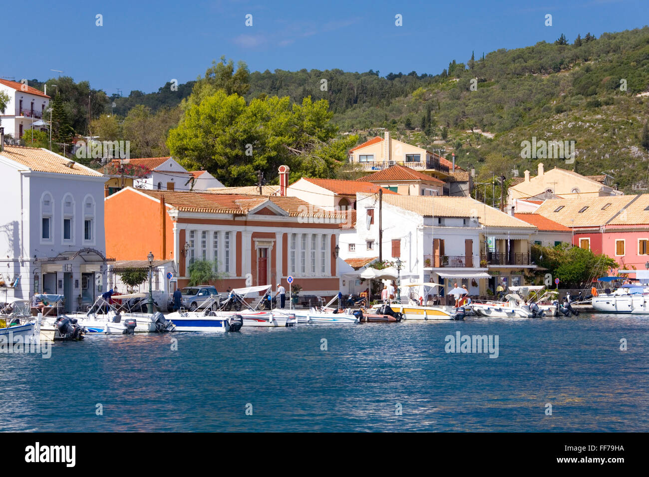 Gaios, Paxos, Ionian Islands, Greece. View across the harbour to colourful waterfront buildings. - Stock Image