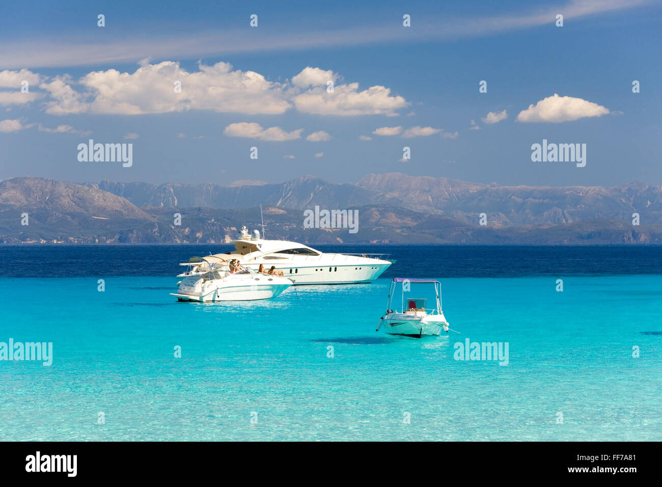 Antipaxos, Ionian Islands, Greece. View across the clear turquoise waters of Voutoumi Bay, boats at anchor. - Stock Image