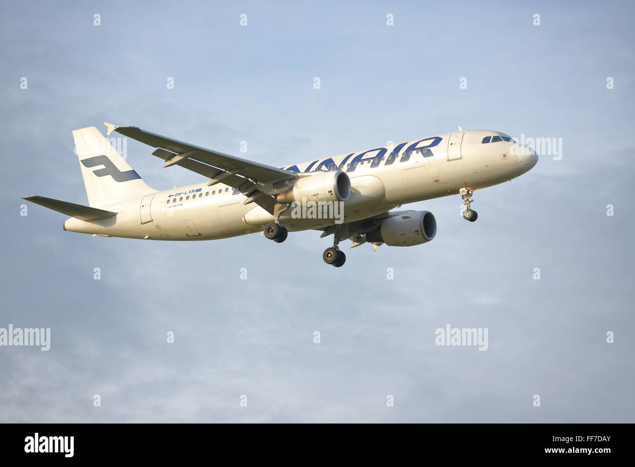 Finnair Airbus A320-200 OH-LXM landing at Heathrow Airport, London - Stock Image
