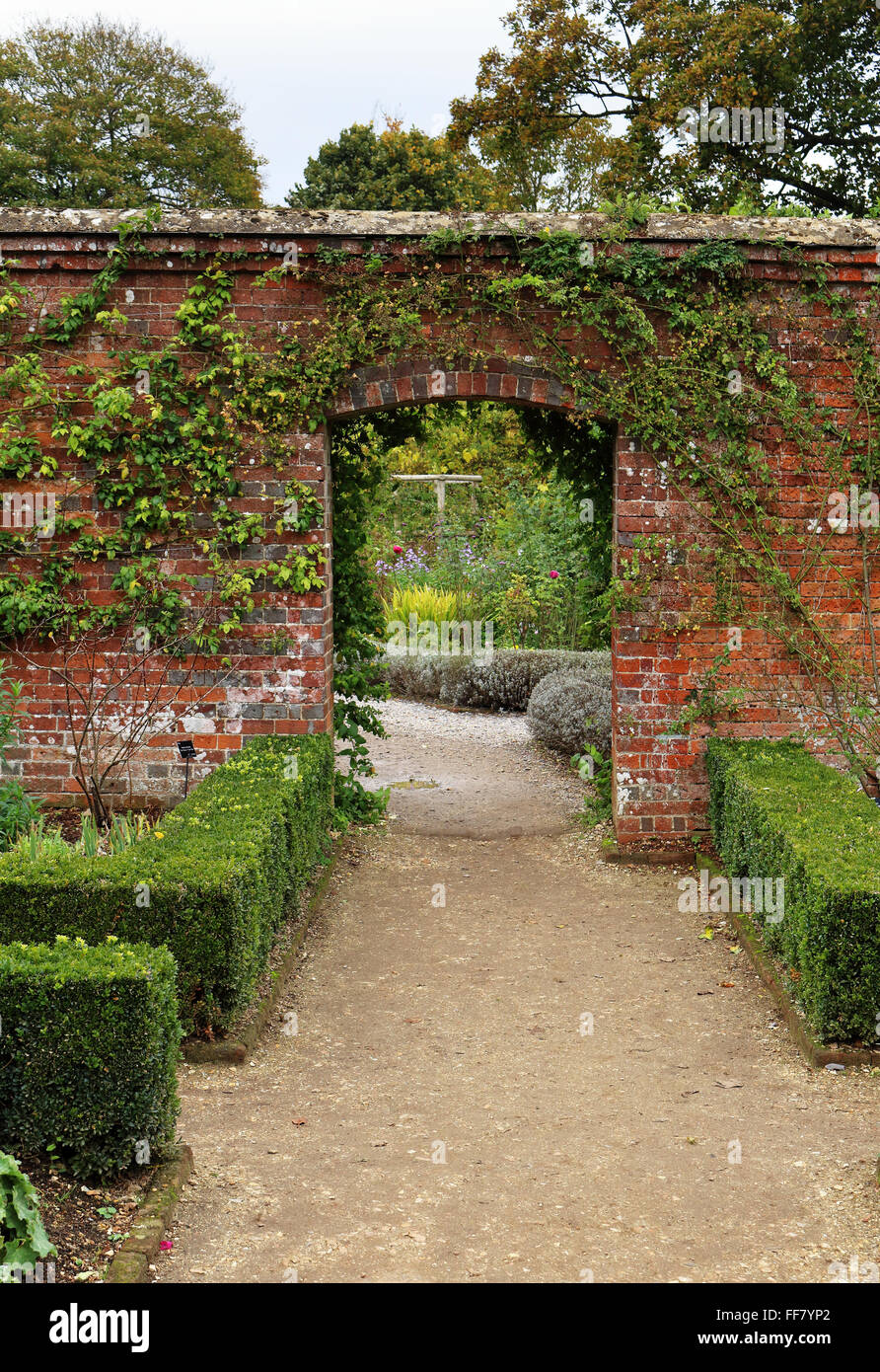 Archway Into An English Walled Garden With Box Hedging   Stock Image