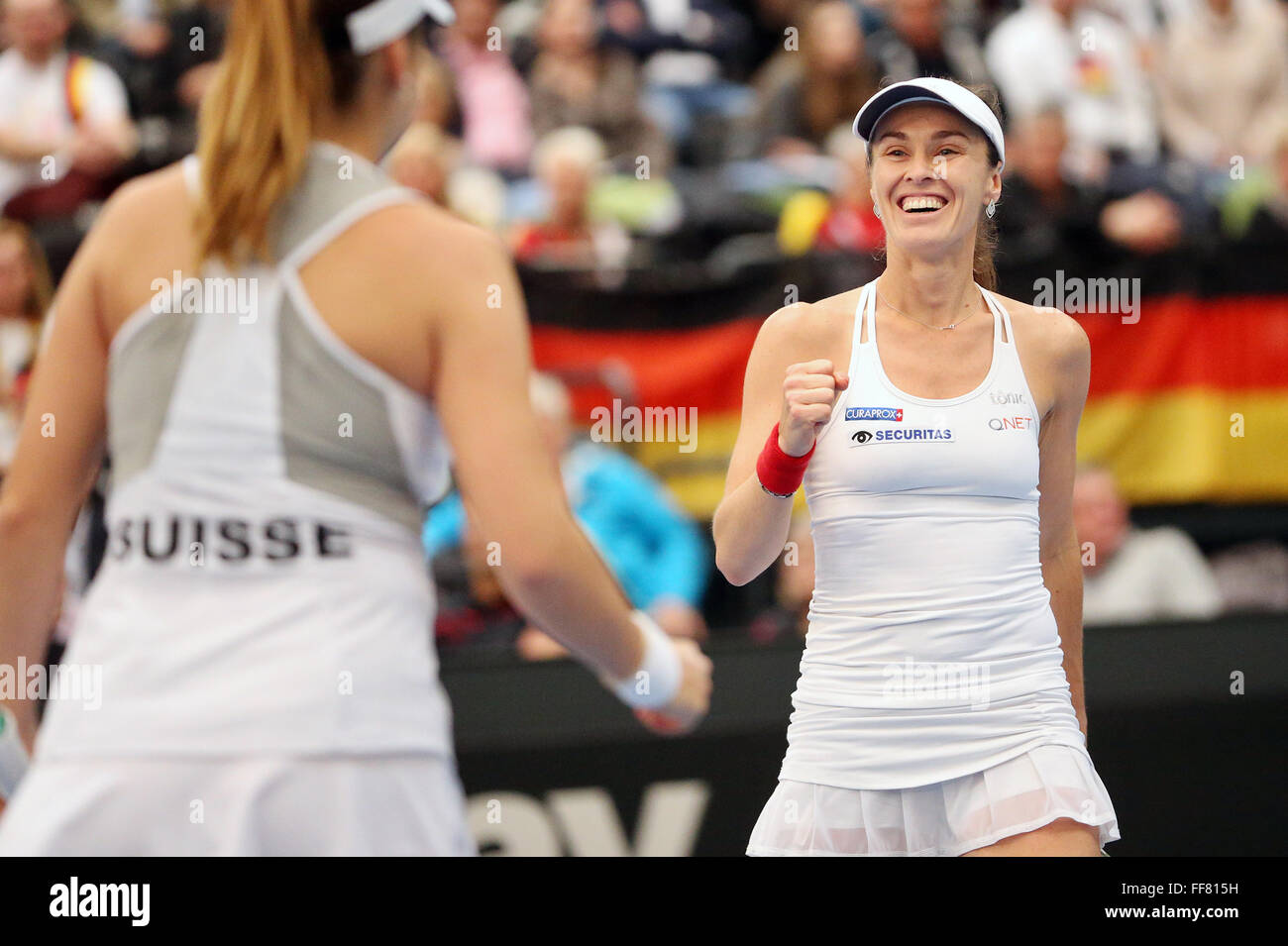 Leipzig, Germany. 07th Feb, 2016. Martina Hingis (R) and Belinda Bencic of Switzerland celebrate after winning their - Stock Image