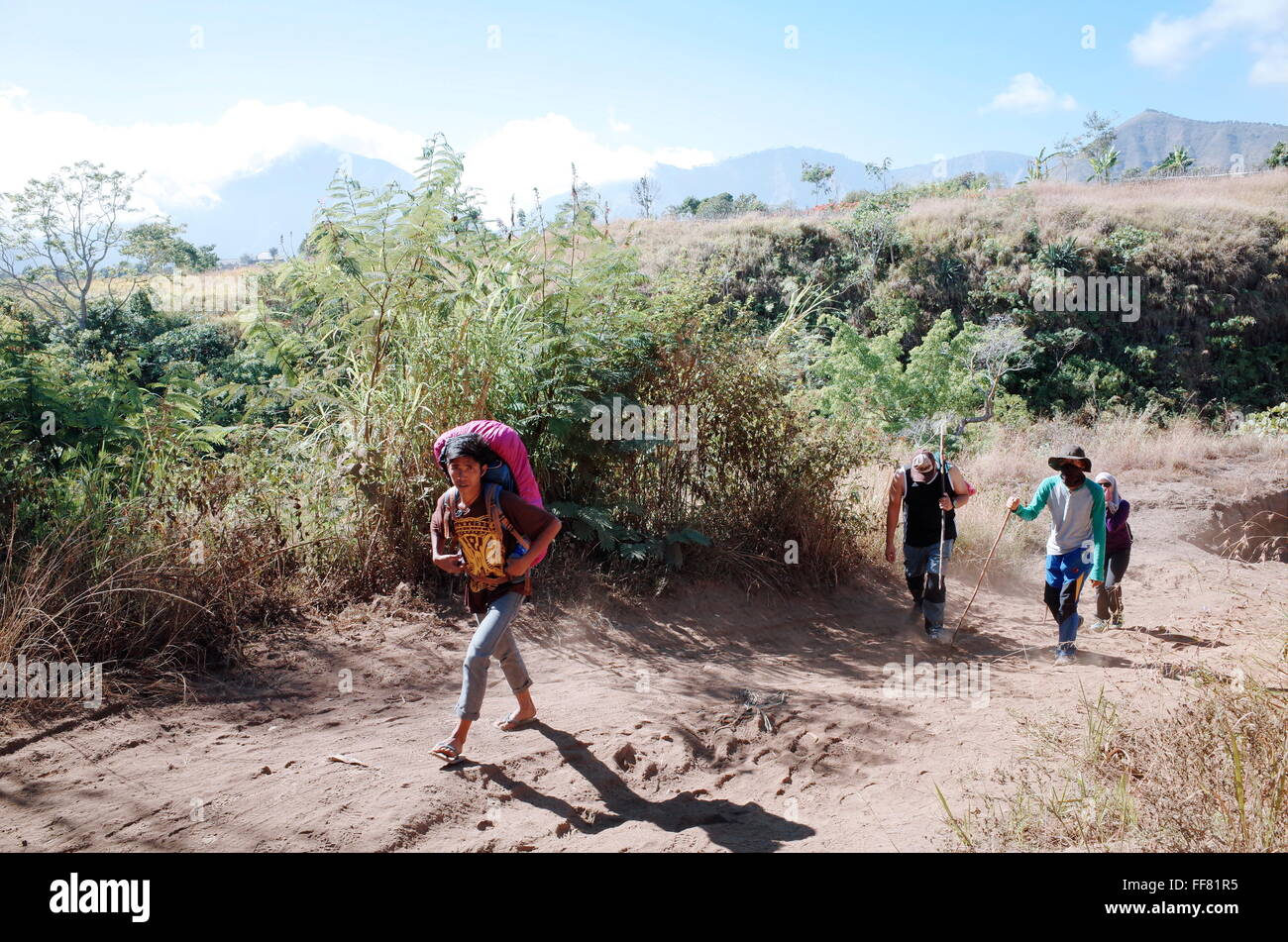 Indoneaian teenager working as a guide in Mount Rinjani - Stock Image