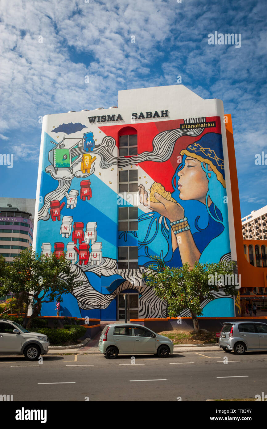 Mural painted on a side wall of a tall building in Kota Kinabalu, Sabah, Malaysia Borneo - Stock Image
