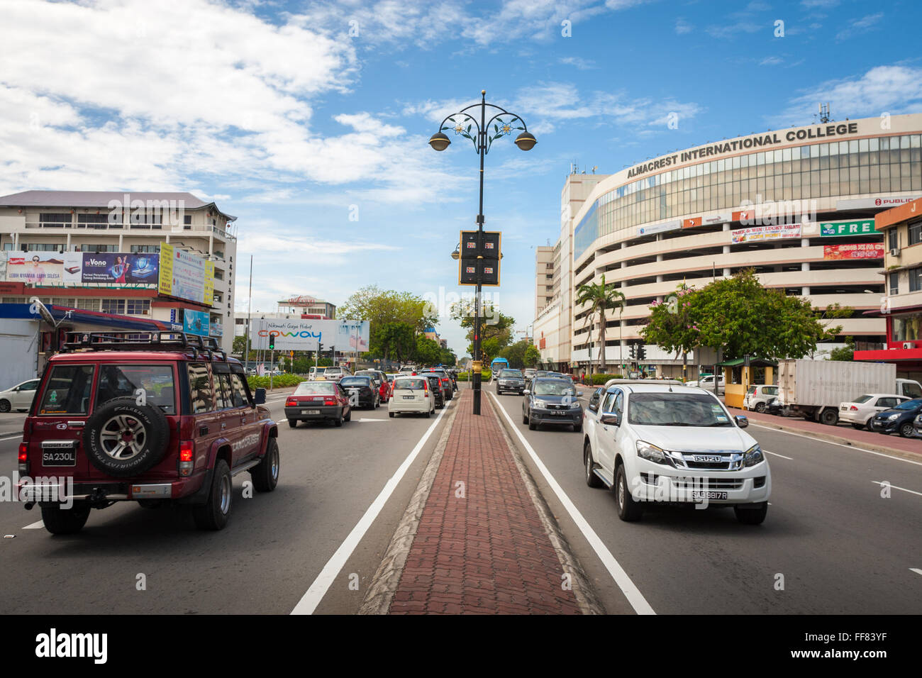 Main thoroughfare through the city of Kota Kinabalu, Sabah, Malaysia Borneo - Stock Image