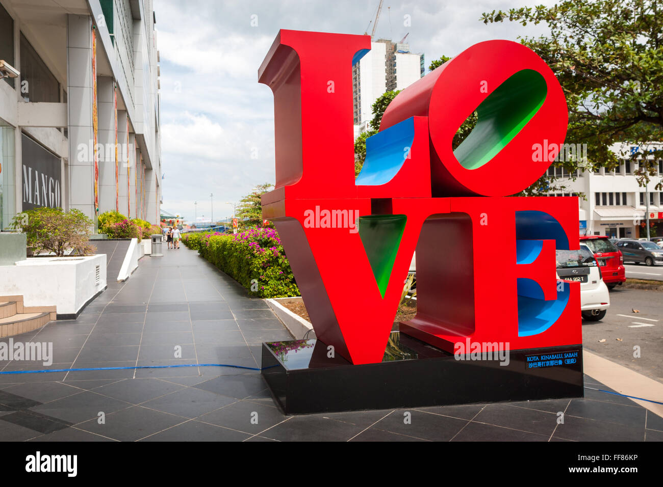 LOVE sculpture based on the art work by Robert Indiana. LOVE is an iconic Pop Art image. Outside Suria Sabah, Kota - Stock Image