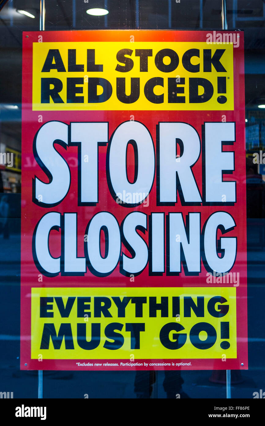 A store closing sale sign displayed in an HMV music in Square Mile, central London, United Kingdom. Due to the economic - Stock Image