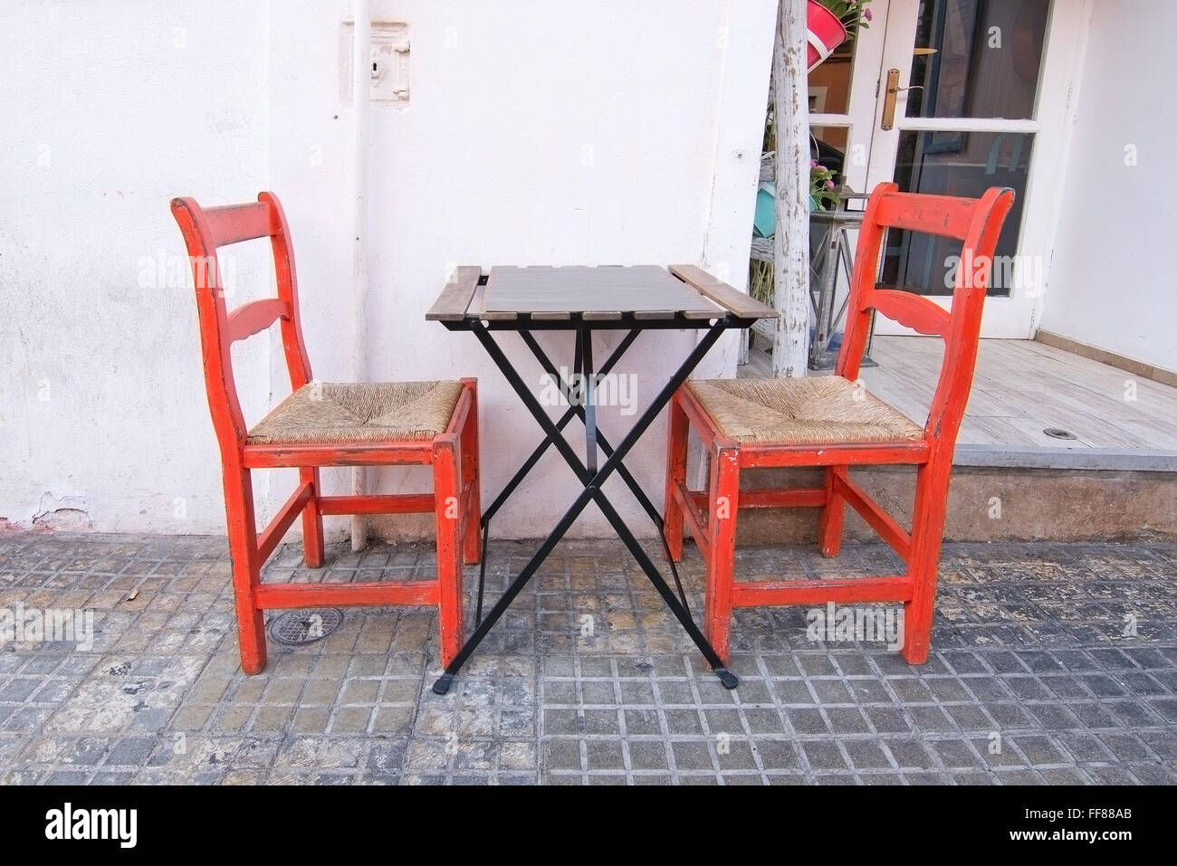 Two Authentic Red Wood And Straw Chairs And Simple Table Outside Stock Photo Alamy