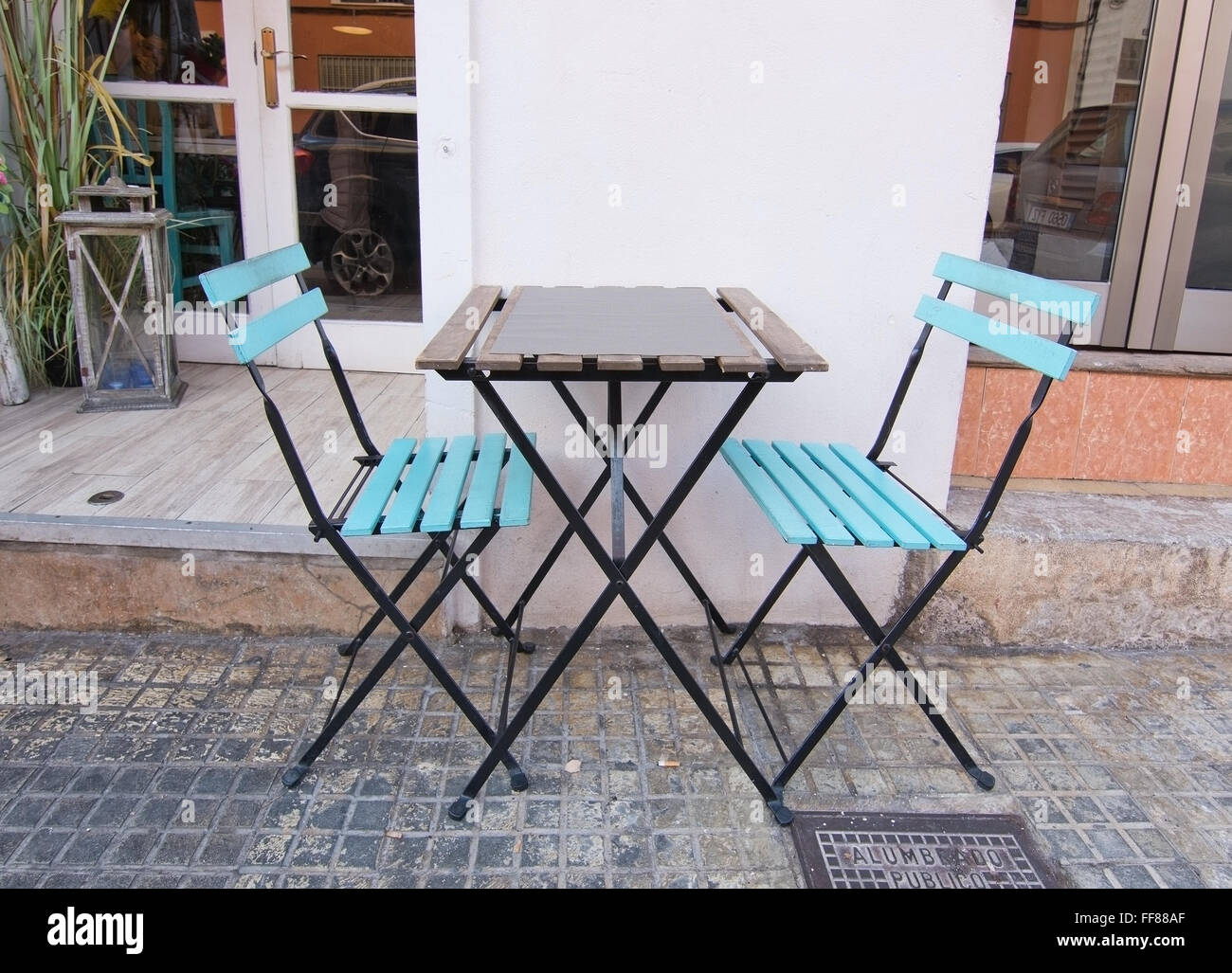 Two Authentic Turquoise Wood And Metal Chairs And Simple Table Outside  Small Restaurant On December 19, 2015 In Palma, Spain