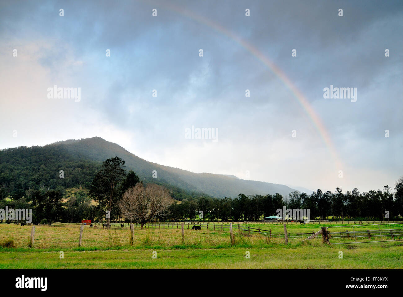 Rainbow arc over the mountain of Gold Coast Hinterland - Stock Image