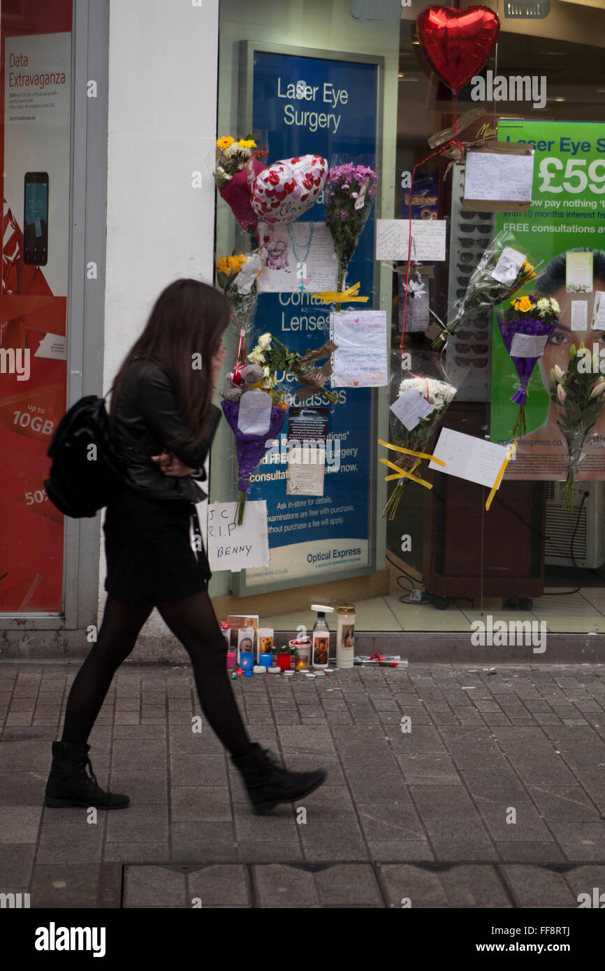 Donegall place, Belfast, 11th February 2016. A Young Woman walks past the spot where Homeless Belfast man 'Jimmy' - Stock Image
