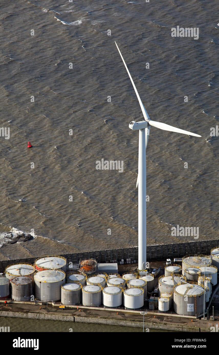 a large wind turbine windmill and storage tanks at Seaforth Docks, Liverpool, UK - Stock Image