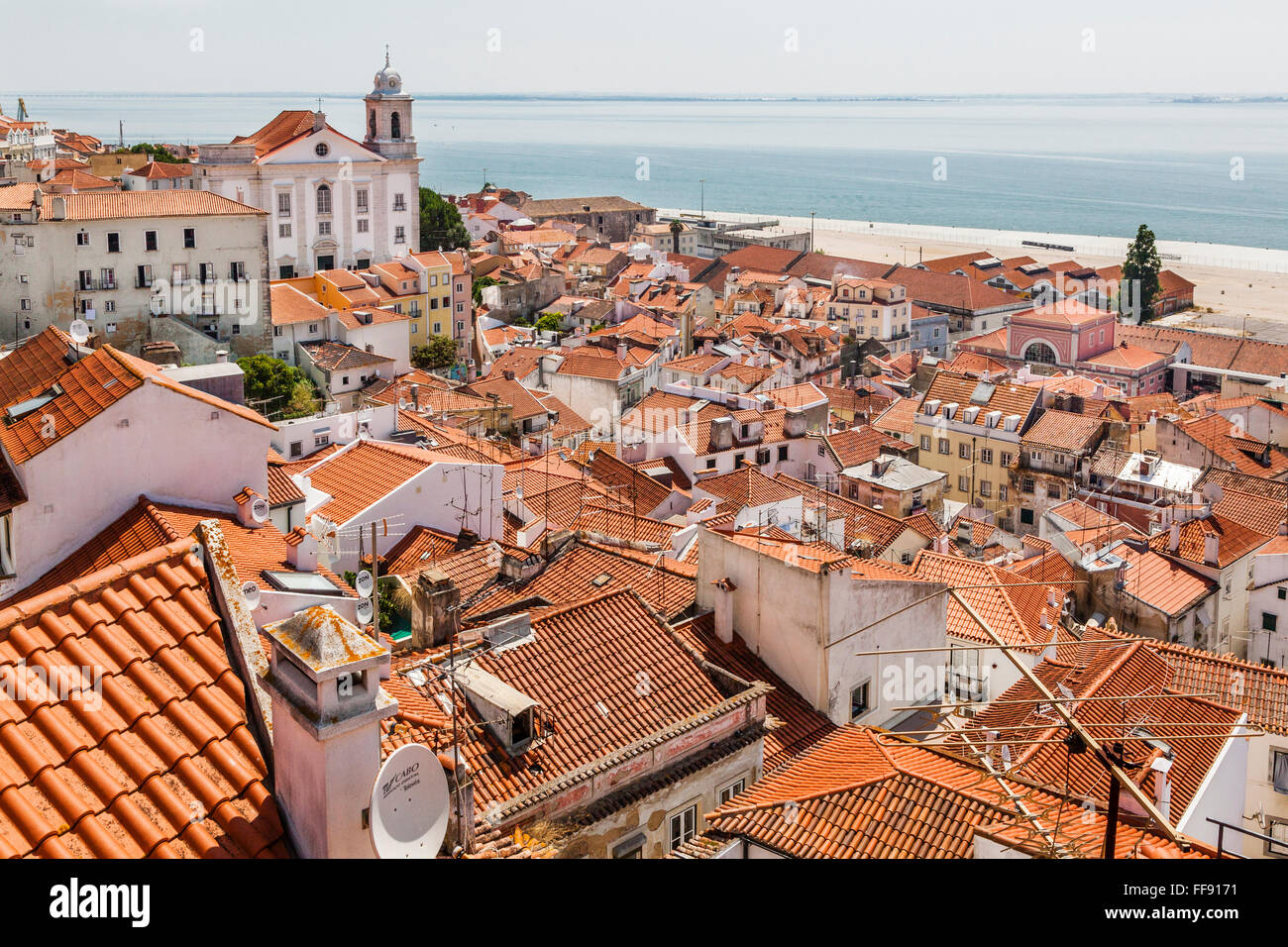 Portugal, Lisbon, view from Miradouro das Portas do Sol of the Tagus River and the roofs of the Lisbon neighbourhood - Stock Image