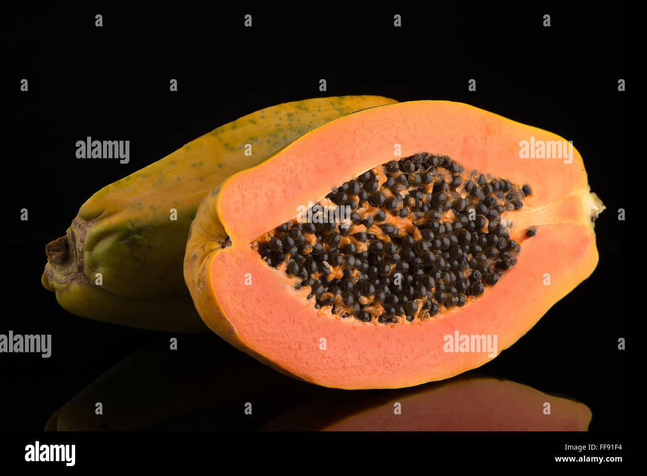 Fresh and tasty papaya on black background. - Stock Image