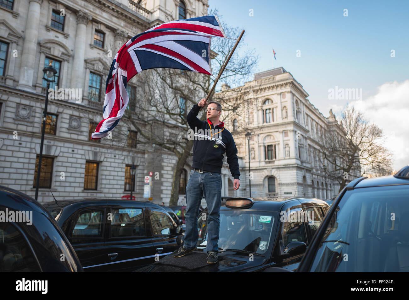 Thousands of London Black Cab drivers block roads in central London to protest against TfL's regulation of Uber, Stock Photo