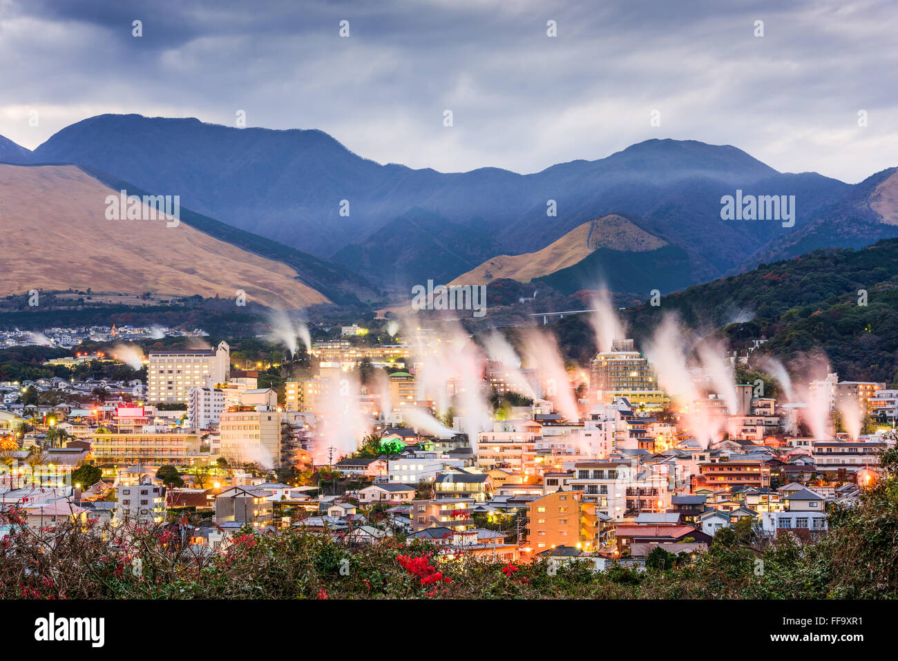 Beppu, Japan cityscape with hot spring bath houses with rising steam ...