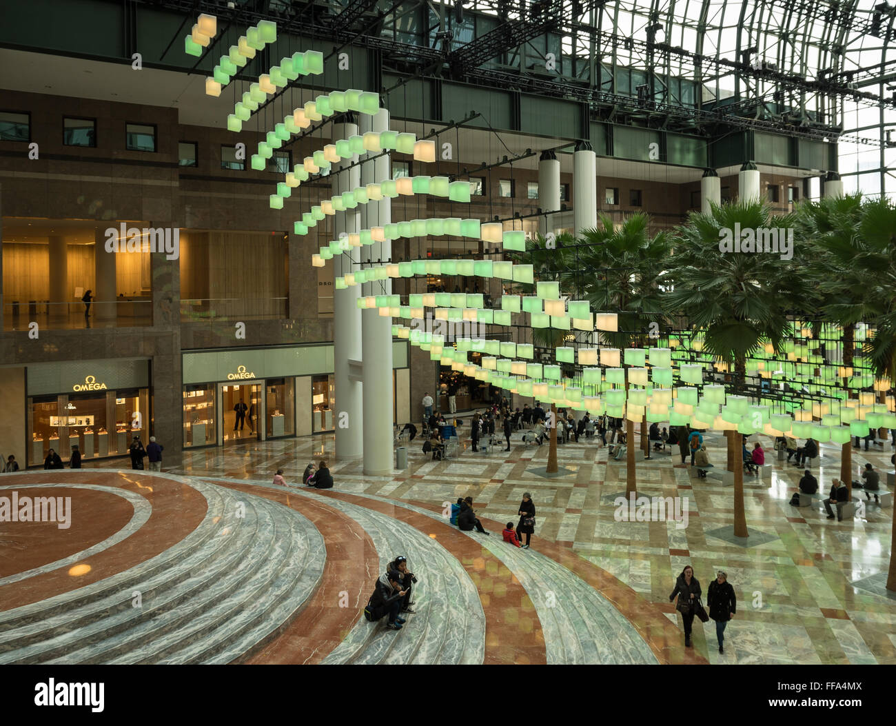 The Winter Garden of Brookfield Place in the Financial District, NYC, with its palm trees and Luminaries light installation - Stock Image