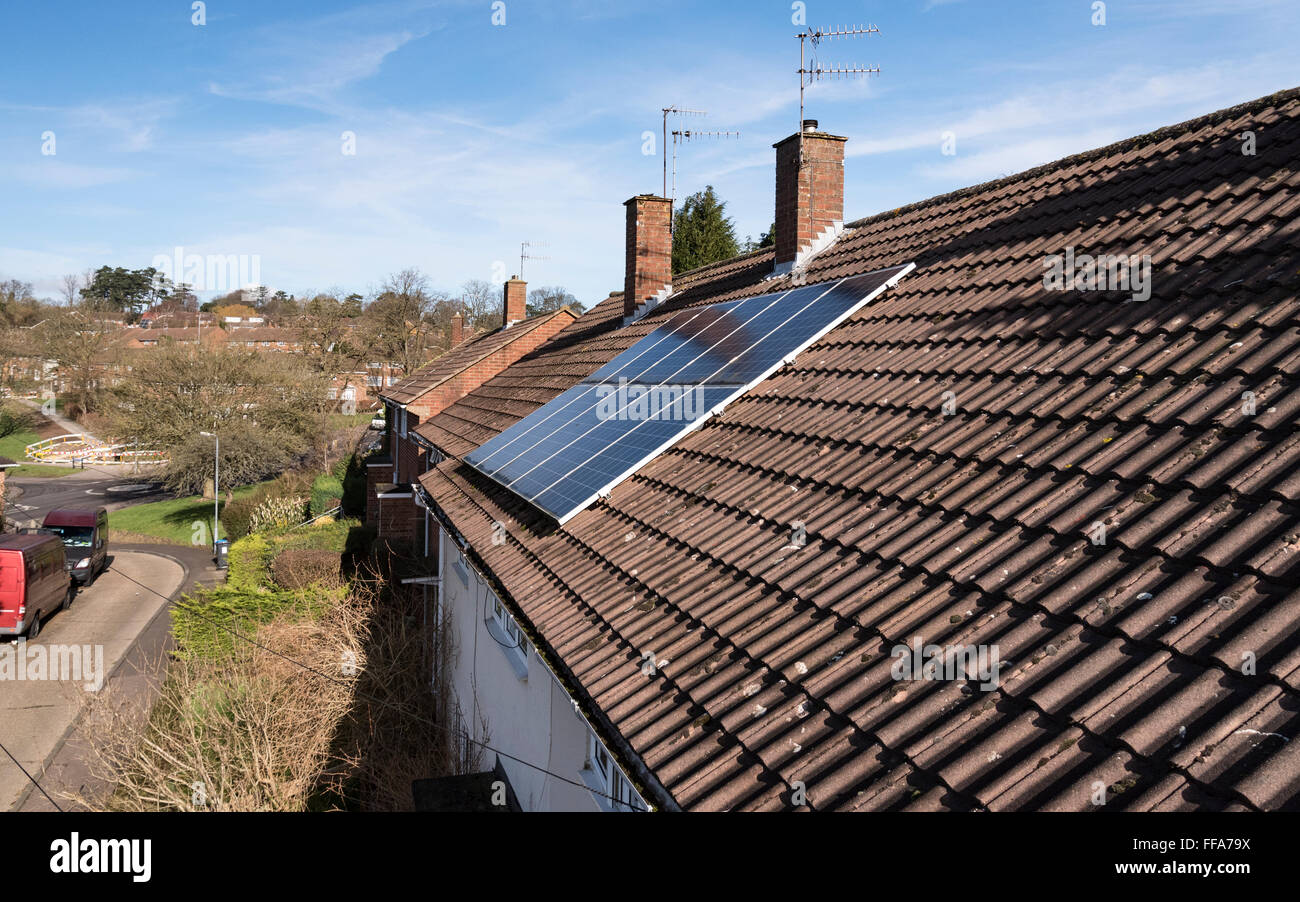 Solar panels on house roof, UK. - Stock Image